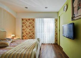 绿色田园风格的卧室装修设计图片